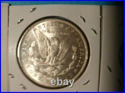 Lot of 1883 Morgan $1, AU, 3 half dollars, 2 quarters, 90% silver, 1 roll 5C